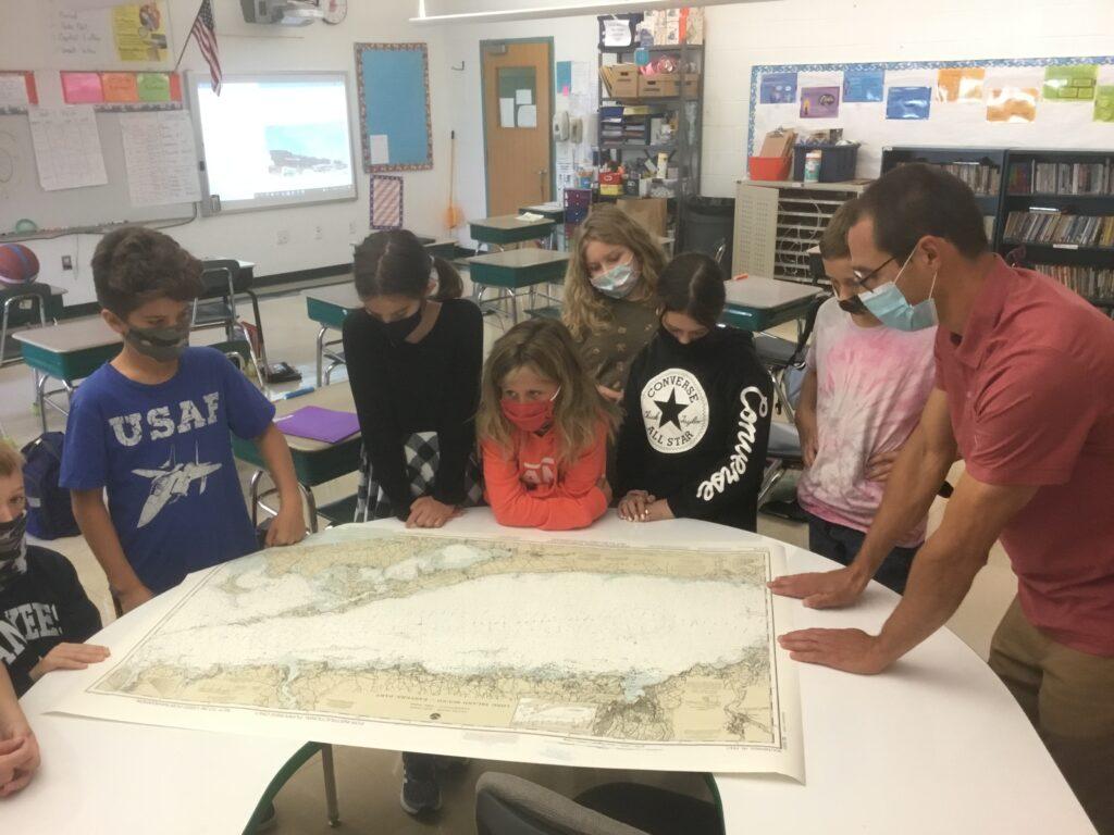students looking at map